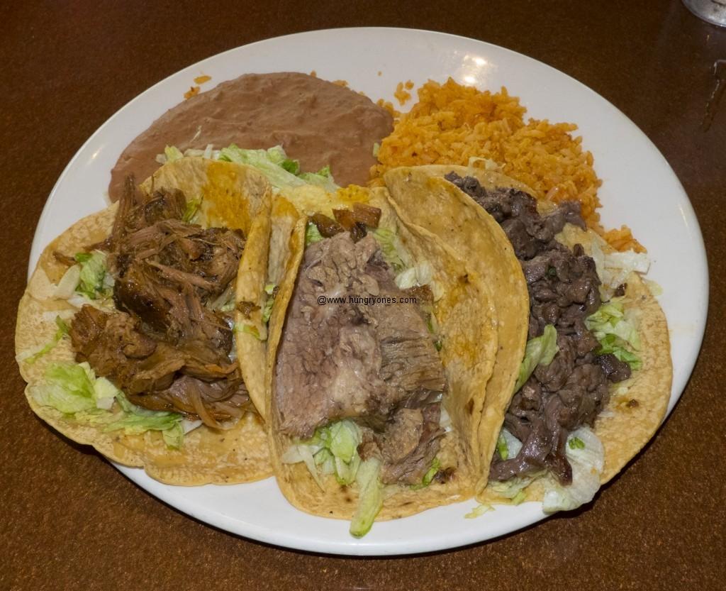 Carnitas, brisket, and carne asada taco.