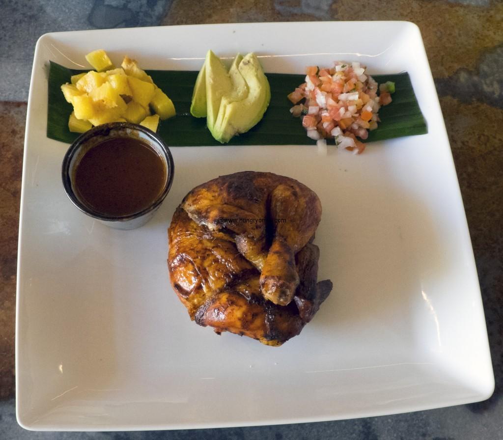 Chicken Annatto with pineapple, avocado, and achoite marinade