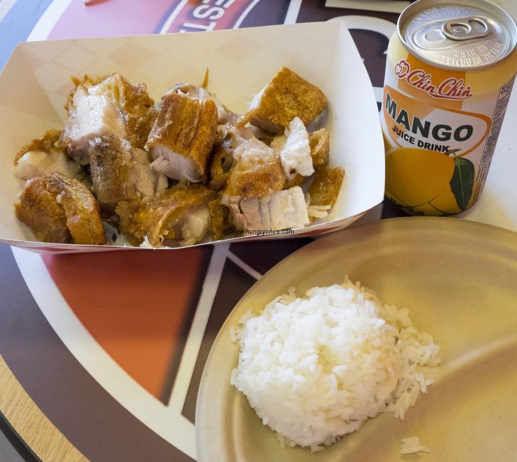 Lechon kawali, jasmine rice, and mango drink.