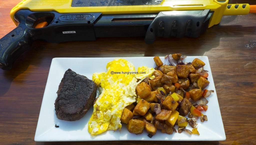 Steak, eggs, country potatoes.  Salt gun in the back.