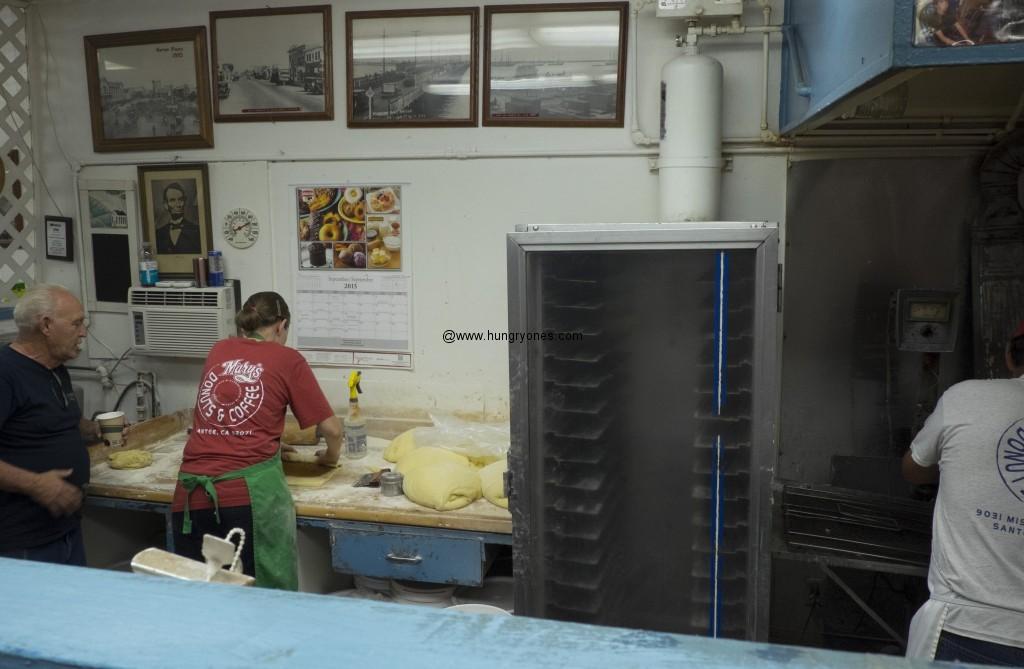 Donut maker at work.