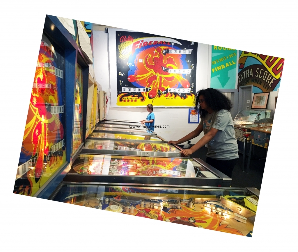 Mari playing pinball.